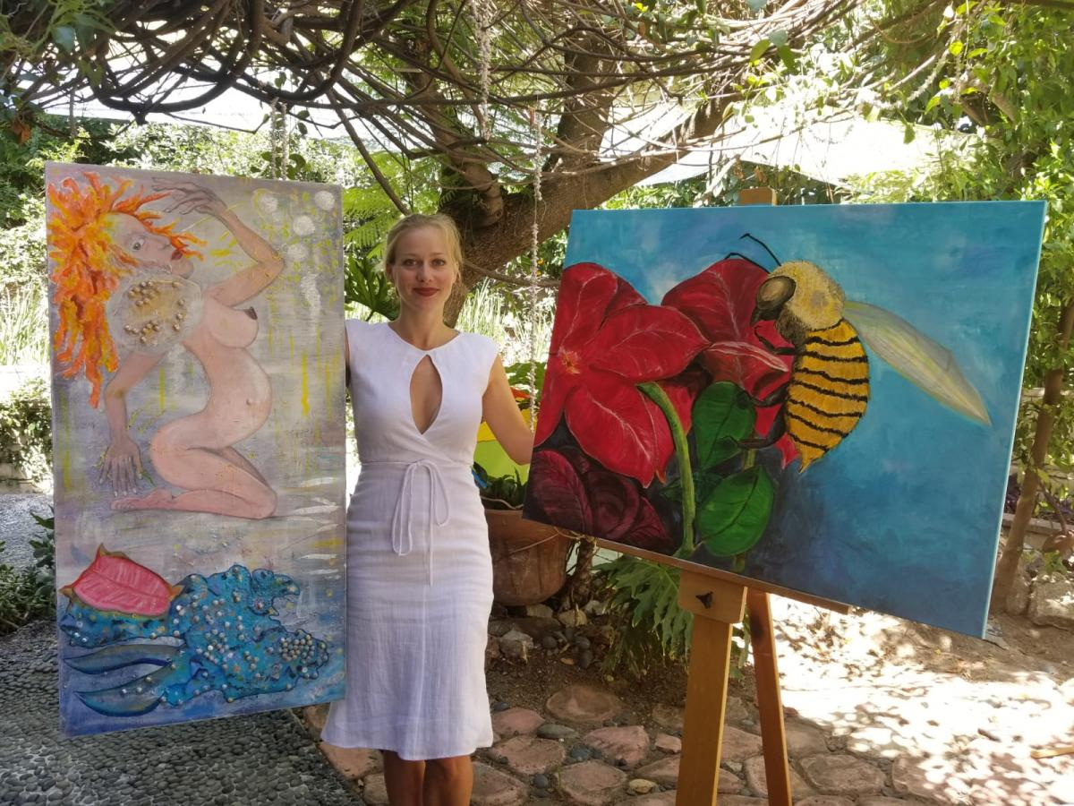 Katarzyna with 2 of her acrylic paintings