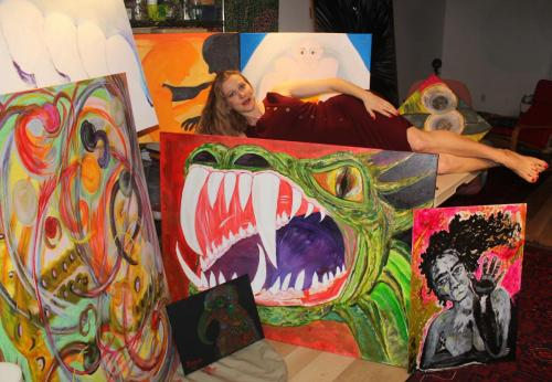 Katarzyna with a few of her paintings